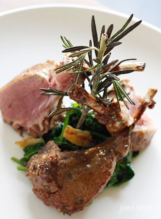 Lamb chops marinated with a glaze of Dijon mustard, garlic, balsamic vinegar and herbs served over a bed of wilted baby spinach in garlic and oil. This is so good you'll be licking the bones clean!
