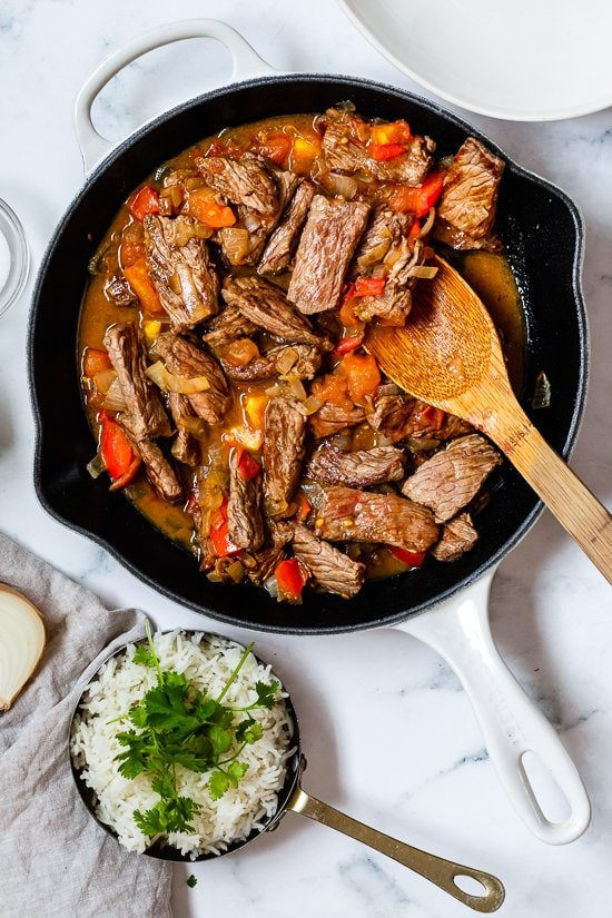 Colombian steak with onions and tomatoes