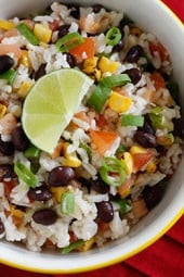 Rice, black beans, tomatoes, scallions, cilantro and lime juice, every bite of this colorful side dish will feel like one big fiesta in your mouth! Use leftover rice and this side dish comes together in minutes.