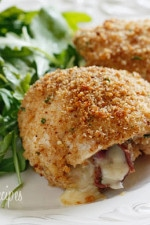 Chicken cutlets dipped in lemon and olive oil, gently coated in a combination of bread crumbs and romano cheese then rolled with prosciutto, cheese and red onion and baked until golden.