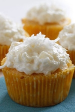 Pineapple and coconut top these light pineapple cupcakes, what a perfect Spring dessert! For the coconut lover out there, these are super easy, low fat, moist and delicious!