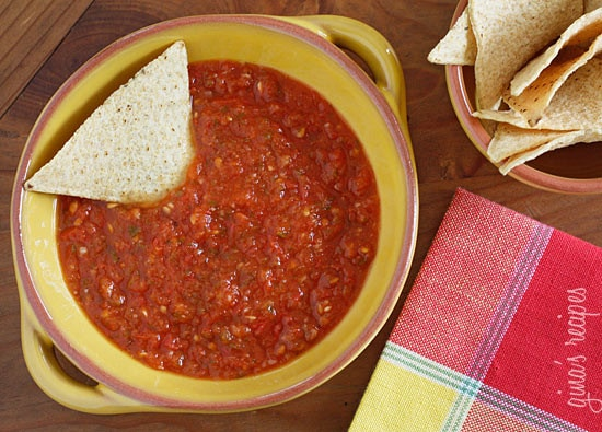 This spicy red salsa is made with fresh tomatoes, roasted jalapeño, garlic and cilantro, pureed in a blender then simmered until the tomatoes deepen in color. Serve with your favorite baked chips and Sinless Margaritas!