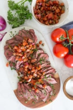 One of my favorite ways to make grilled steak in the summer. Topped with fresh chopped tomatoes, red onion, balsamic and oil. It's fresh and a great way to enjoy those end-of-summer tomatoes!