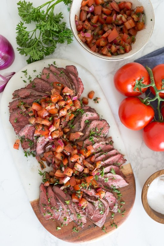 One of my favorite ways to make grilled steak in the summer is topped with fresh chopped tomatoes, red onion, balsamic and oil. It's fresh and a great way to enjoy those end-of-summer tomatoes!