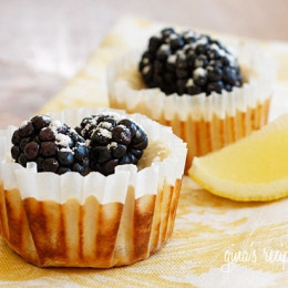 Lemony cheesecake cups made with Greek yogurt topped with fresh berries. Light, creamy and virtually guilt-free!