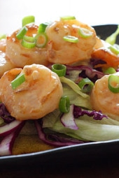 Stir fried shrimp mixed with a creamy sweet and spicy chili sauce served on a bed of shredded lettuce and purple cabbage topped with scallions. This is a bangin' good slimmed down copycat recipe of Bonefish Grill's very popular Bang Bang shrimp. Takes about 10 minutes to prepare which makes this perfect for lunch, as an appetizer or even a light meal.
