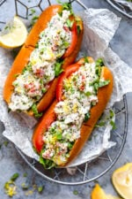 Lobster Rolls scream summer to me! Made with chunks of chilled lobster tossed with celery, shallots, chives, light mayonnaise and a little lemon zest served on a hot dog bun – delicious!