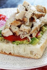 An open faced sandwich on Ciabatta bread with mashed avocado, sliced tomatoes and grilled chicken. A perfect way to use up leftover chicken.