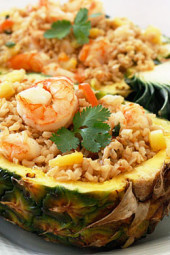 Pineapple Shrimp Fried Rice has a delicious flavor combination of savory, sweet and spicy. Serve it in hollowed out pineapples for a beautiful presentation!