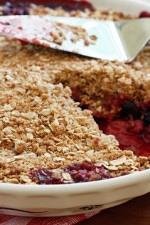 When summer berries are at their peak, make this warm berry crisp and enjoy it with a scoop of frozen yogurt or whipped cream. This is delicious with any combination of berries and leftovers makes a great breakfast with some yogurt.