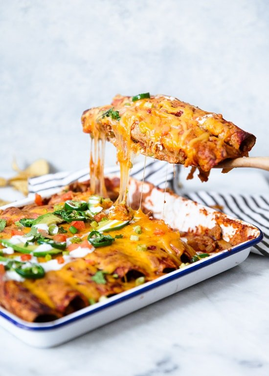 Skinny Chicken Enchiladas are perfect if you're an enchilada lover like me! As good as any recipe you'll find in a restaurant (if not better) only much lighter!