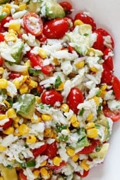 A wonderful summer salad made with lump crab meat, summer tomatoes, sweet charred roasted corn, cilantro, hot peppers and zesty lime juice. Serve this over mixed greens or tostadas as a main dish or you can put this in martini glasses as a fancy appetizer.