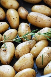 A quick, fabulous side dish made with teeny tiny mini potatoes and fresh garden herbs such as rosemary made on the stove or roasted on the grill. Minimal effort with excellent results.