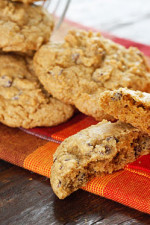 A fabulous Fall pumpkin spiced chocolate chip cookie! This is what happens when you take the Best Low Fat Chocolate Chip Cookie Recipe and swap out the apple sauce for pumpkin puree, then add lots of pumpkin pie spice!