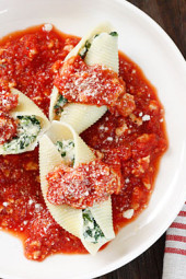 Jumbo pasta shells stuffed with ricotta cheese, mozzarella and spinach topped with a turkey meat sauce. Here's a great way to sneak spinach on your kids' plate!