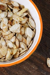 Roasted pumpkin seeds are fun and simple to make with your kids, especially after you just finished carving it; they also make for a healthy snack!