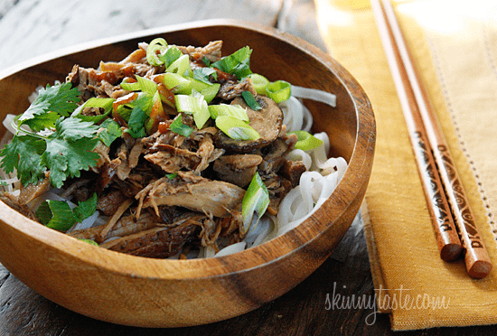 Boneless pork roast slow cooked in Asian spices creates a aromatic pork dish with mushrooms and broth, perfect over noodles or rice with fresh chopped green onions, cilantro and sriracha.