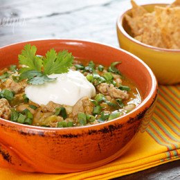 A perfect fall chili made with pumpkin puree, ground turkey, white beans, green chili and spices. Top this with chopped fresh cilantro, scallions, jalapeños, light sour cream, and/or reduced fat cheddar and serve it with baked chips on the side for a wonderful lunch or dinner.