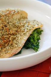 Tilapia filets topped with crushed pumpkin seeds, panko and seasonings, then baked until golden. This is super easy to make and is ready in less than 30 minutes.