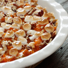 Sweet potatoes, golden raisins, crushed pineapple and spices are topped with pecans and mini marshmallows, then baked until golden.