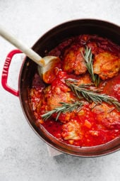Pollo in Potacchio is an Italian braised chicken dish made with tomatoes, rosemary and garlic. The chicken cooks until it's fork tender, which is great served with pasta, noodles, spaghetti squash or polenta.