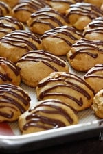 Low-fat pumpkin spice cookies have a cake ball quality to them, drizzled with a chocolate glaze, they are seriously good!