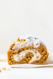 This classic pumpkin roll recipe is made lighter than traditional recipes with a delicious pumpkin spiced sponge cake and a light cream cheese filling.