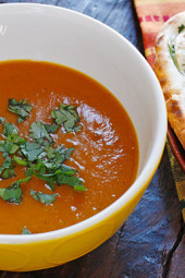 Coconut milk, cumin, garam masala, curry powder and cilantro balance the sweetness of the roasted red kuri squash, creating this aromatic Indian inspired soup. Serve this with a piece of garlic naan and you have yourself a meal.