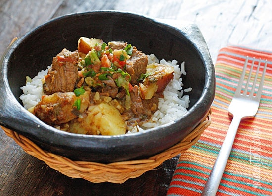 Chunks of beef are simmered in beer with scallions, garlic, tomatoes, cumin and cilantro. Sometimes I make it with just the meat, sometimes I add yucca or potatoes. Serve this over rice with a little aji picante and you'll have a delicious comfort dish, Latin style!