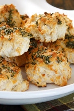 The scent of Garlic + Rosemary + Baked Bread is absolutely intoxicating to me. Seriously, my stomach starts to growl just thinking about it. I've always been more of a savory girl; I can bake a dozen cupcakes and not eat one, but place a batch of these biscuits in front of me... different story.