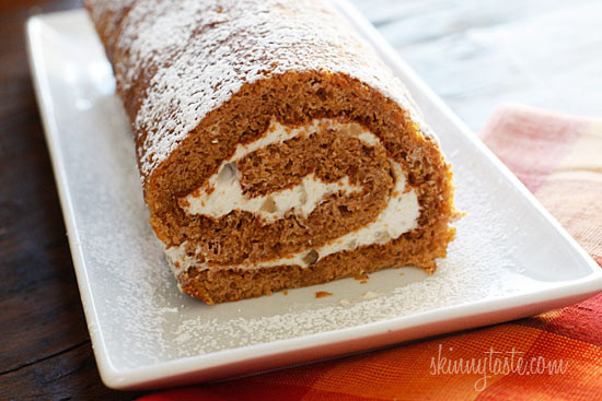 Pumpkin sponge cake rolled with a lightened up cream cheese frosting. What can be prettier on your Thanksgiving table!