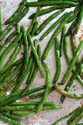 Roasted Green Beans topped with Parmesan come out perfectly charred and tender – SO good, I can literally eat the whole batch and made with just four ingredients!