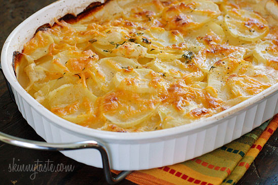 Skinny Scalloped Potato Gratin – Thinly sliced yukon gold potatoes, layered and baked in a light buttery sauce and shredded cheese. So good without the guilt!