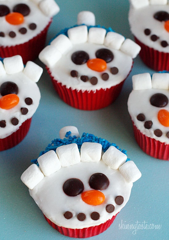 With Christmas just around the corner, these adorable holiday vanilla snowman cupcakes are low fat, easy to make and they are a hit with the kids!