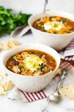Chicken Enchilada Soup has everything you love about chicken enchiladas... in one big bowl of soup!