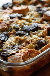 A make-ahead breakfast casserole made with day old bread, eggs, cheese, sausage and mushrooms. You can make this with just about anything, just use your imagination!
