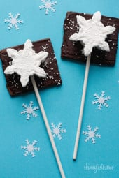Smores Pops – Chocolate graham crackers coated with melted chocolate and marshmallows on a stick. A fabulous winter treat whether you want to make them as favors or just have fun making them with the kids.