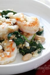 Shrimp, white beans and wilted spinach topped with crumbled feta. Perfect for a weeknight meal, this dish is delicious and super easy to make!