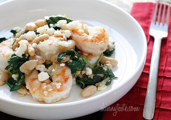 Shrimp, white beans and wilted spinach topped with crumbled feta ...