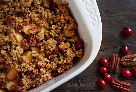 Delicious, comforting and perfect for your Holiday table! Apples and cranberries topped with oats, nuts and a little brown sugar are baked to a crisp in the oven and served warm. Now this is my kind of comfort food!