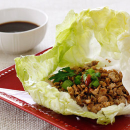 These quick and easy authentic Asian Chicken Lettuce Wraps are so delicious, made with sautéed ground chicken thighs, shiitake mushrooms and water chestnuts seasoned with Asian spices served in a crispy cold lettuce leaf with a spicy hoisin dipping sauce.