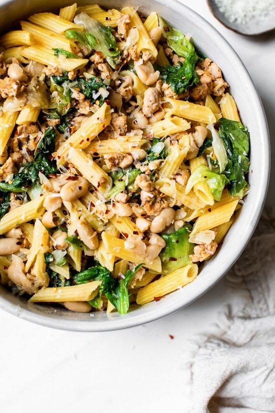 Pasta with Italian Chicken Sausage, Escarole and Beans is ridiculously good made with lots of garlic, lean Italian chicken sausage, and white cannellini beans.