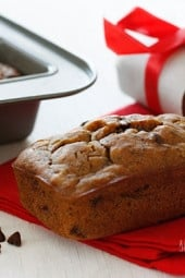 Whole wheat mini banana bread made with ripe bananas and chocolate chips are sure to leave a smile on anyone's face.