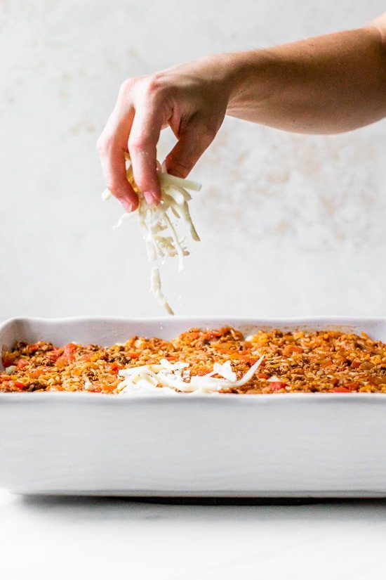 This Stuffed Cabbage Casserole is basically a deconstructed version of stuffed cabbage layered with shredded cabbage, ground beef and brown rice cooked in tomatoes then topped with melted cheese