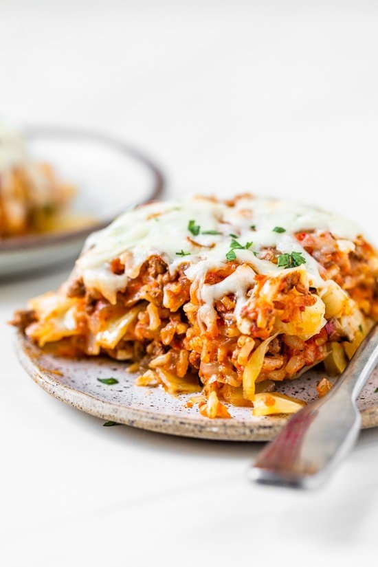 This Stuffed Cabbage Casserole is basically a deconstructed version of stuffed cabbage layered with shredded cabbage, ground beef and brown rice cooked in tomatoes then topped with melted cheese. It's SO good!
