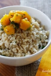 Coconut milk, brown rice, coconut flakes, fresh ginger and cilantro are combined to create this simple side dish, perfect to accompany many Thai dishes.