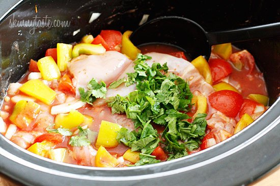 Crock Pot Chicken a la Criolla – In this simple yet flavorful dish, boneless skinless chicken thighs are stewed in the slow cooker with bell peppers, onions, garlic, tomatoes, olives, cilantro and spices. Served over rice.