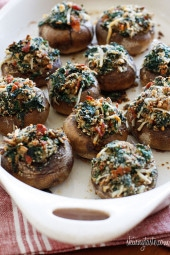 Spinach and Bacon Stuffed Mushrooms stuffed with sautéed baby spinach, chopped mushrooms, bacon, bread crumbs and Parmesan cheese – a lighter alternative to traditional stuffed mushrooms yet loaded with tons of flavor!
