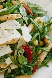 Peppery arugula tossed with nutty chick peas, penne pasta, sun dried tomatoes, shaved parmesan and balsamic vinegar make a simple yet delicious main dish salad – perfect for lunch or dinner. Portions are large, loaded with fiber and very satisfying.