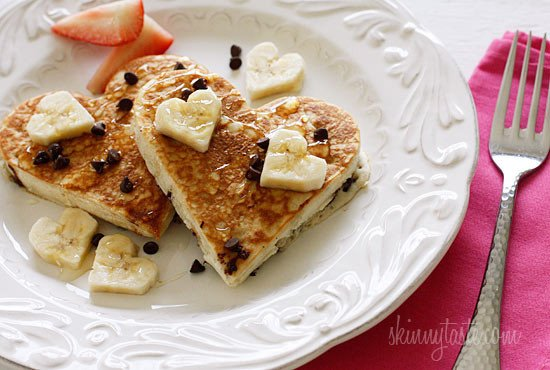 Valentine's Day is coming up and I can't think of a better way to start the morning than with these fabulous light and fluffy Chocolate Chip Banana Pancakes!